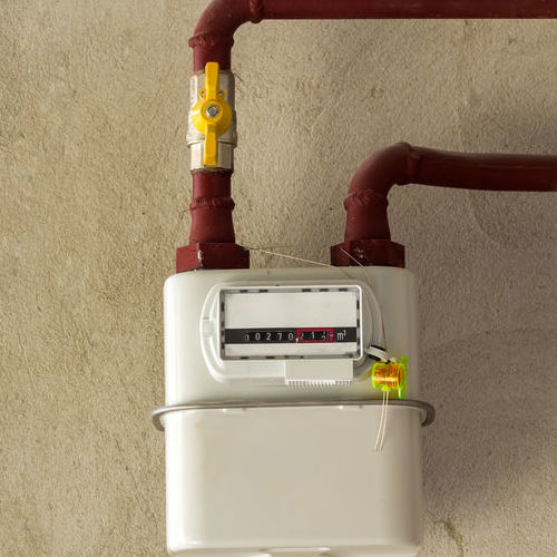 A Gas Line Attached to a Residential Gas Meter.