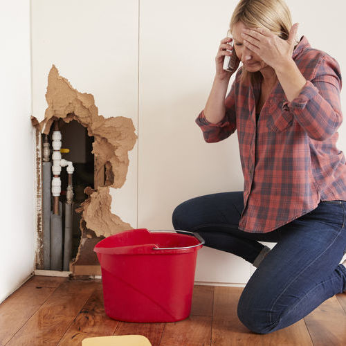 A Woman Calls for Burst Pipe Repair Service.