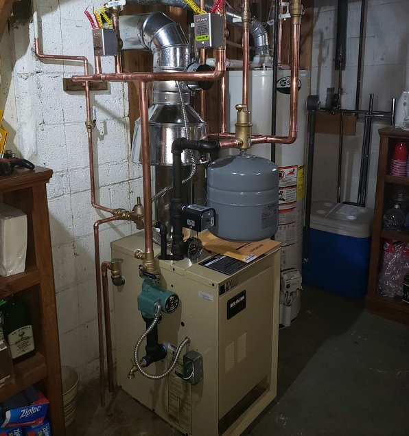 A Picture of a Boiler with a Tank.