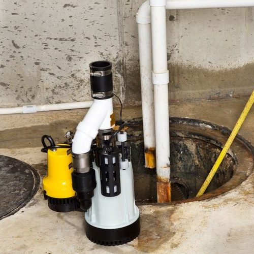 A Picture of a New Sump Pump Being Installed.