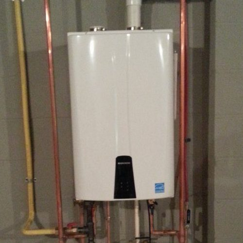 A Picture of a White Tankless Water Heater.